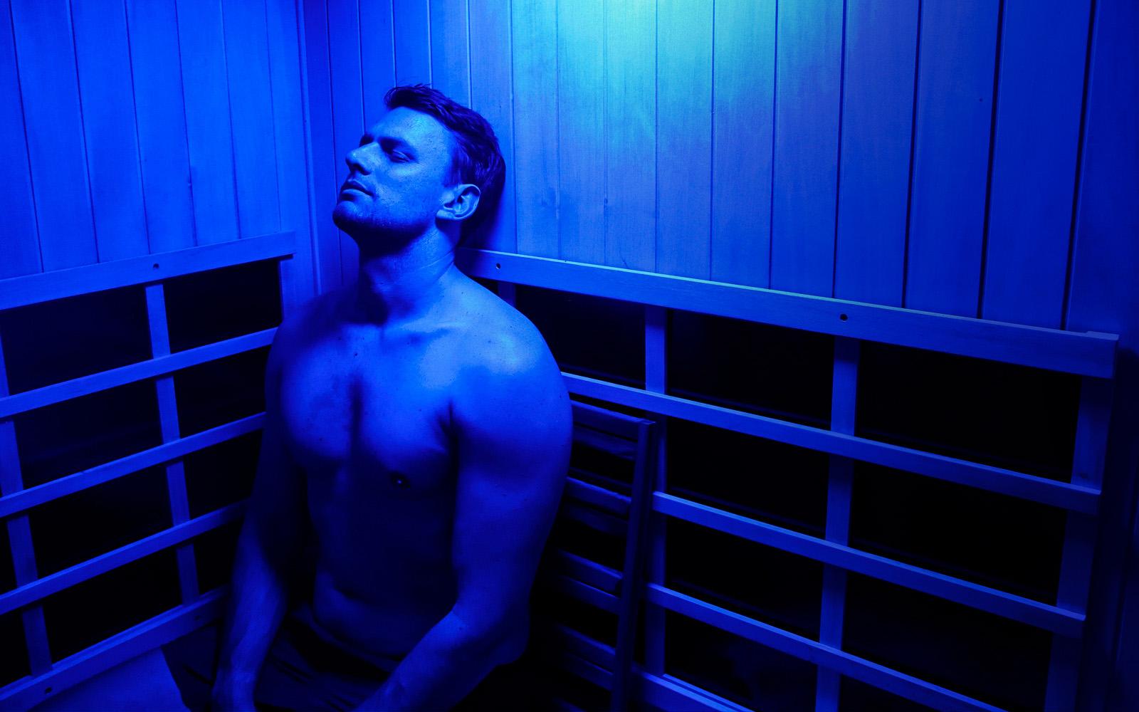 man using infrared sauna in Brisbane